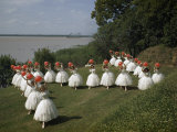 Costumed Ballet Dancers Pose on a Lawn Overlooking Mississippi River