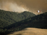 Firefighting Plane Prepares to Drop Retardant on a Forest Fire