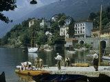People Gather on Dock Below Summer Villas Overlooking Lake