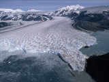 Aerial View of a Glacier and Nearby Mountains