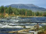 Man Standing on Riverbank at Abol Falls Looks Toward Mount Katahdin