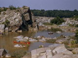 Men Paddle Canoes on a Tranquil Backwater Above Great Falls