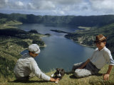 Men with Puppy Overlook Hourglass-Shaped Lakes in Volcanic Crater