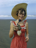 Teenage Girl Holds a Toheroa  a Marine Clam Native to New Zealand