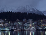 Quaint Fishing Village in the Shadow of Snow-Blanketed Mountains