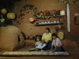 Family Prepares Tortillas Beside an Adobe Beehive-Shaped Oven