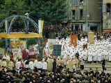 Penitents in White Robes and Worshipers Attend Open-Air Ceremony