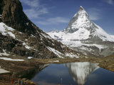 Tourists View the Matterhorn and its Reflection in Alpine Lake