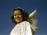 Portrait of a Girl Dressed Up as an Angel for an Easter Procession