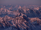 Aerial View of Snow-Dusted Jagged Majestic Mountains