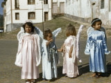 Girls Dress Like Angels in Robes  Crowns  and Wings for Easter Parade