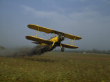 Crop Duster Soars Low to the Ground to Spray a Cotton Field