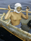 Diver for Seaweed Adjusts Her Face Mask