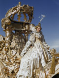 Young Circus Performer Dressed as Cinderella Rides an Ornate Float