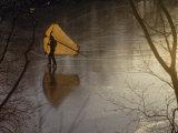 Man Kite-Skating on a Frozen Pond