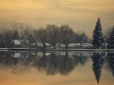 Winter Scene in and its Reflection in a Lake