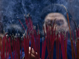 Chinese Man Lighting Incense at a Buddhist Temple