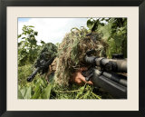 Airmen Hidden in Brush Wearing Their Ghille Suits