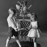 Children Pulling a Christmas Cracker  1962
