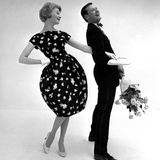 Model Wearing a Puff Ball Skirt and Escort with Roses  1958