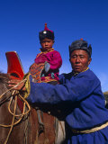 Karakorum  Horse Herder and His Son on Horseback  Mongolia