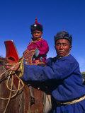 Karakorum  Horse Herder and His Son on Horseback  Mongolia