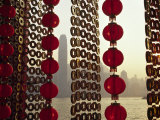 Curtain of Chinese New Year Decorations Frame Victoria Harbour from Tsim Sha Tsui  in Hong Kong