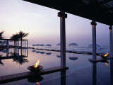 Reflections in the Still Water of the Infinity Pool at Sunset  at the Chedi Hotel