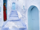 Local Woman Steps Out into Whitewashed Streets of Rif Mountains Town of Chefchaouen  Morocco