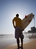 A Surfer Looks Out to the Waves at Manly Beach on Sydney&#39;s North Shore  Australia