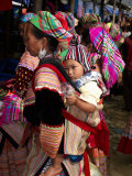 Flower Hmong Woman Carrying Baby on Her Back  Bac Ha Sunday Market  Lao Cai Province  Vietnam