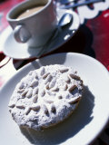 Pine Nut Cakes Dusted with Icing Sugar and Served with Coffee are a Local Speciality