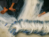 Detail of Feet Being Used to Repair Fishing Nets  Vietnam