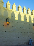 Woman Walks under the Ancient City Walls of Fez  Morocco