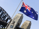 An Australian Flag Flutters in Breeze in Front of Iconic Sydney Harbour Bridge  Sydney