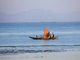 Tthe Crew of Small Fishing Boat Hurries Home to Sittwe Harbour with their Catch  Burma  Myanmar
