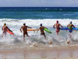 Surf Lifesavers Sprint for Water During a Rescue Board Race at Cronulla Beach  Sydney  Australia