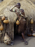 Datoga Woman Relaxes Outside Her Thatched House  Tanzania