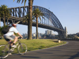 An Early Morning Cyclist Rounds Daves Point Reserve at Foot of Harbour Bridge  Sydney  Australia