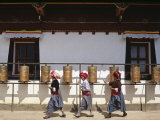 Mosu Women Push Prayer Wheels at a Small Monastery on Liwubi Island  China