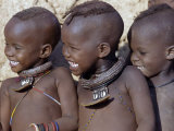 Three Happy Himba Children Enjoy Watching a Dance  Namibia