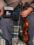 Blind Street Musician Holds His Violin in One Hand and His Collecting Box in the Other