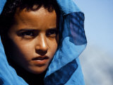 Young Girl in Characteristic Saharan Blue Headscarf Looking into Distance  Sahara  Southern Morocco