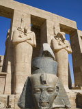 Headless Statues of Ramses Ii Line the Courtyard at the Entrance to the Ramesseum  Luxor  Egypt