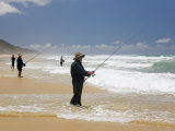 Queensland  Fraser Island  Fishermen Wade into the Surf on Seventy-Five Mile Beach  Australia