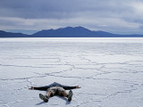 Tourist on Salt Crust of Salar De Uyuni  Emphasising Scale of Largest Salt Flat in World  Bolivia