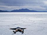 Tourist on Salt Crust of Salar De Uyuni  Emphasising Scale of Largest Salt Flat in World  Bolivia