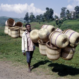 Man Carries Traditional Split-Bamboo Baskets to Sell at Kisoro Market  Southwest Uganda