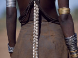 Young Dassanech Girl Wears a Leather Skirt  Metal Bracelets  Amulets and Bead Necklaces  Ethiopia