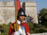 Mdina  Guard in Historic Costume of Templar Knight Stands Outside Medieval Walled City  Malta